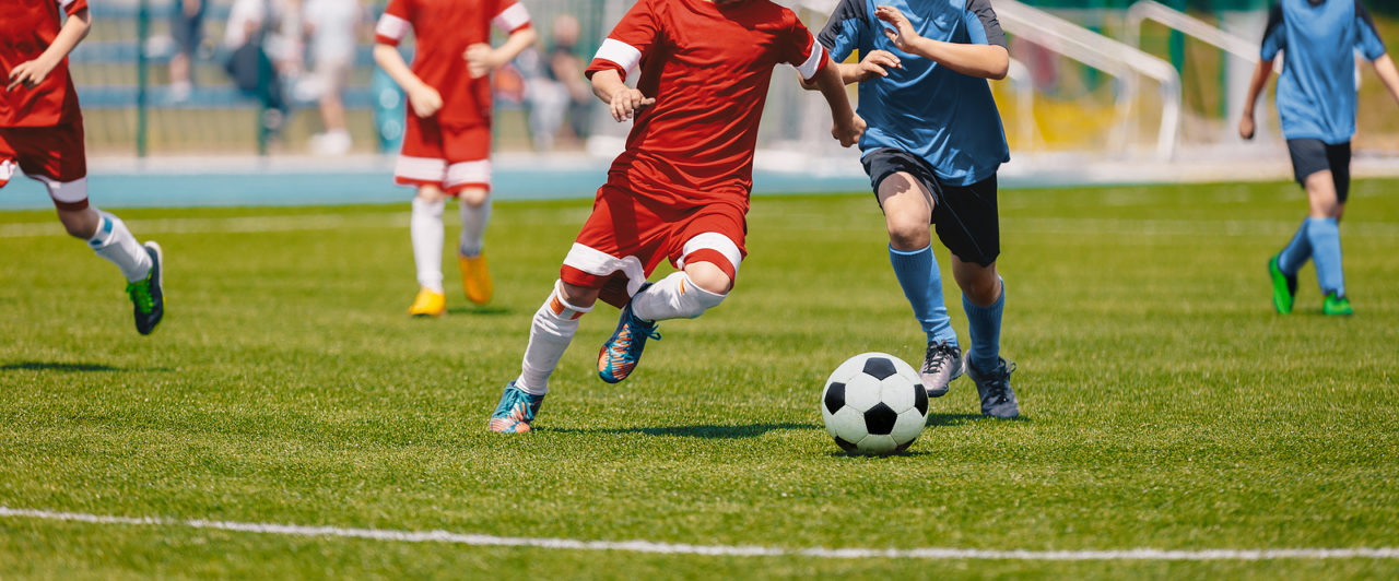 bigstock-Football-Soccer-Players-Runnin-283317868-1280x532.jpg
